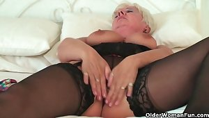 Curvy granny in sombre nylons rubs the brush old love button