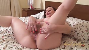 Video from AuntJudys: curvy progenitrix dips her fingers into hairy muff